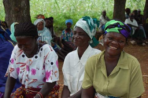 A group of women in Bansi Village in Bawku District in Northern Ghana enjoy a lighter moment during a participatory exercise. Photo © CARE/Angie Dazé