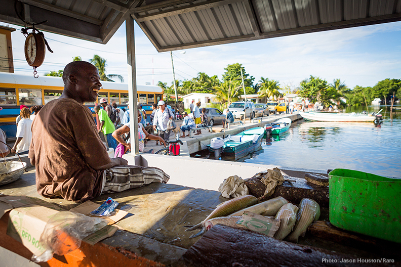 Fishermen sell their fish directly from their boats to this local market in central Belize City.