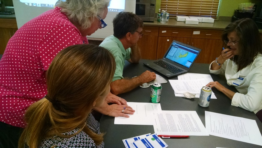 During a Coastal Resilience workshop in North Carolina, attendees work in teams to use the Restoration Explorer App in combination with community-scale ecological, social, and economic data to prioritize subtidal oyster restoration projects for shoreline protection. Photo © TNC