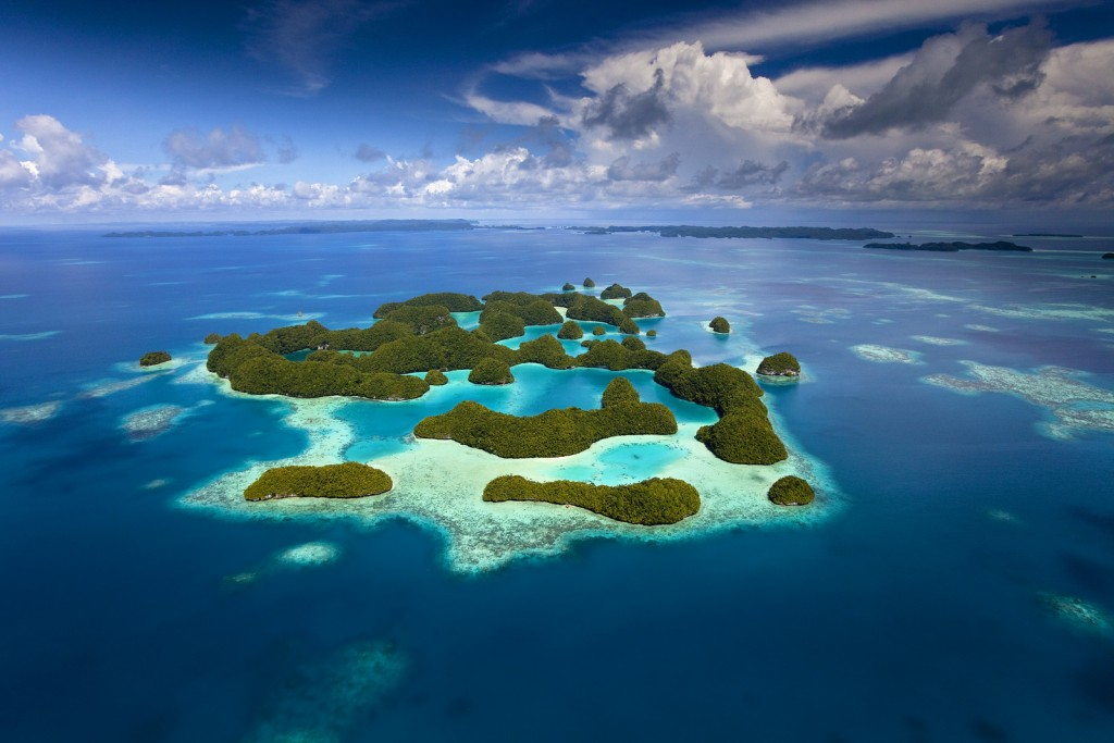 "Aerial view of Palau known as ""70 Mile Islands"" as well as the rich coral reef surrounding them. Photo © Ian Shive"