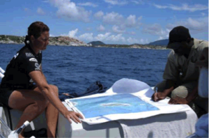 Shannon Gore, Conservation and Fisheries Dept., and Finfun Peters, National Parks Trust of the Virgin Islands, ground truthing sites using aerial photographs as a guide. Photo © BVI National Parks Trust