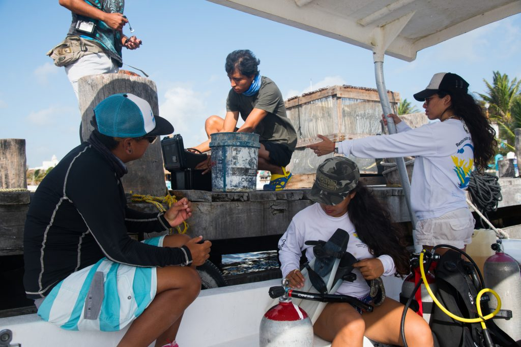 Brigade members load the boat and prepare their scuba gear for a day of training on the water. Photo © Jennifer Adler