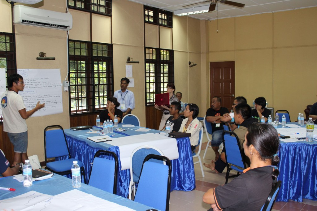 Small group reporting on potential management actions during bleaching events. Photo © James Tan Chun Hong